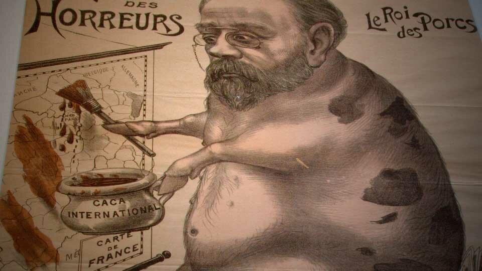 """Caricature antisémite relative à l'affaire Dreyfus, issue de la série """"Le musée des horreurs"""" de Victor Lenepveu. Ici, Zola, """"Le roi des porcs"""", barbouille la France de """"caca international"""" !"""